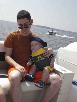 Little boys and their daddies get sleepy on the water!