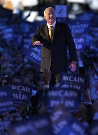 John McCain makes his way through Hurricane Palin on Thursday night at the RNC.